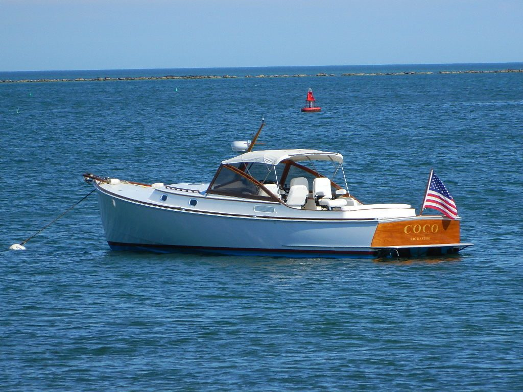 Coco boat anchored by Brant Point